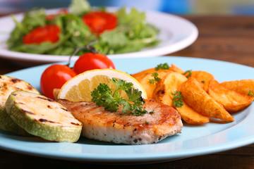 Grilled steak, grilled vegetables and fresh green salad
