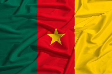 Cameroun flag on a silk drape waving