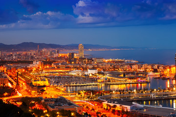 Port Vell and cityspace in Barcelona during evening