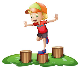 A young boy playing with the stump