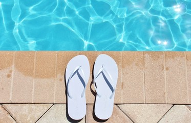 Poolside swimming pool holiday vacation scenic flip flops thongs stock, photo, photograph, image, picture,