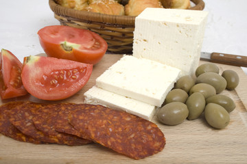 Mediterranean breakfast - Cheese, sausage, tomato and olives on
