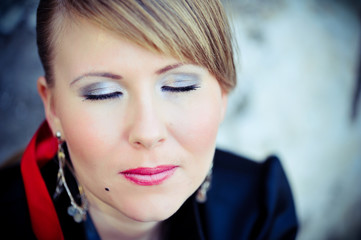 closeup face with makeup blonde girl with closed eyes