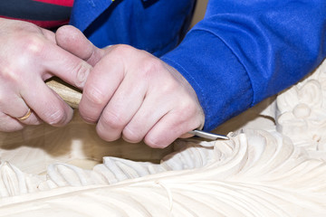 man engaged in woodcarving