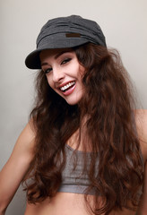 Beautiful smiling female with long hair in hat