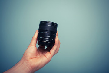 Hand holding extension tubes