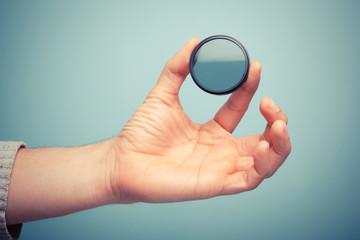 Hand holding polarizer filter