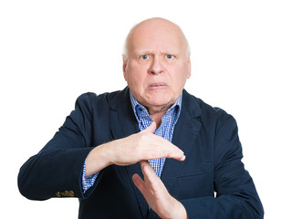 Portrait senior man giving timeout hand gesture white background