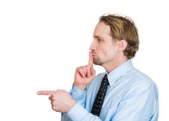 Side view profile man pointing finger asking to be quiet