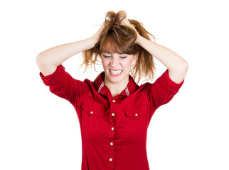 Stress. Overwhelmed young woman pulling out her hair
