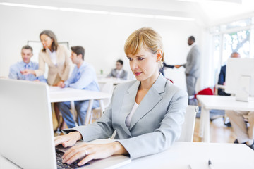 Working Businesswoman in Front of Her Laptop