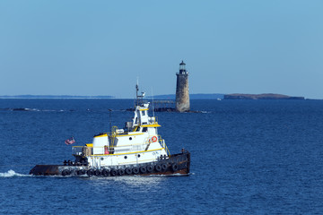 Portland, Maine - Tug boat in front of Lighthouse