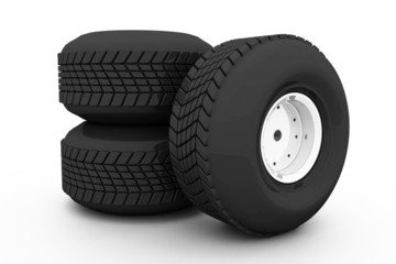 Stack of three wheel. Tyres for car.