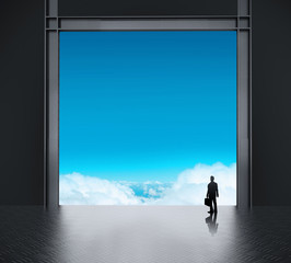 businessman thinking in factory and looking to sky as concept