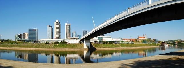The Vilnius city walking bridge with skyscrapers