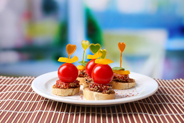 Wall Mural - Tasty canapes with salami,tomato, pepper  and basil leaves,
