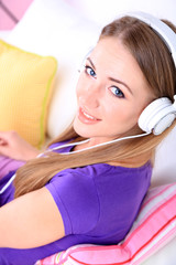 Conceptual image of  audio book. Beautiful girl with mobile