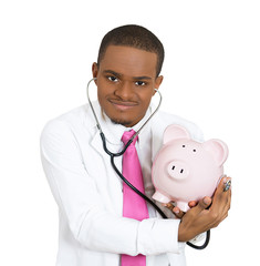 Doctor with piggy bank budget and savings concept