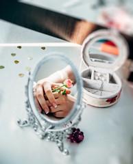 Bride hands reflected in cute mirror
