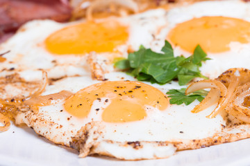 Breakfast with fried eggs beacon and onion