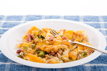 Bowl of Has Brown Potatoes with Ham Broccoli and Cheese