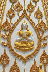 thai style statue and molding art on the wall temple