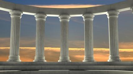 Ancient marble pillars in elliptical arrangement with orange sky Wall mural