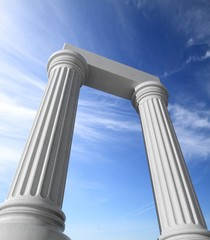 Two white ancient marble pillars with blue sky