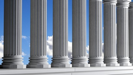 Ancient marble pillars in a row with blue sky