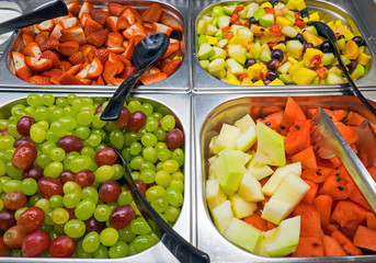 Different kinds of fruit salad seen at a buffet
