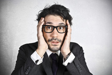 Astonished businessman with glasses