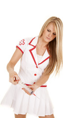 nurse with big shot needle looking down