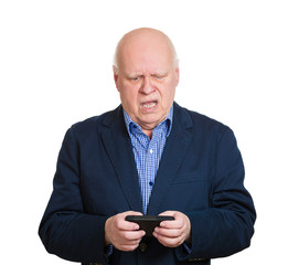 Portrait old man pissed off at a text message, white background