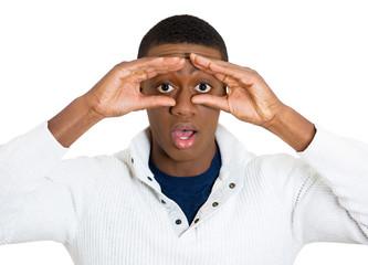 Peeking through. Curious, surprised man on white background
