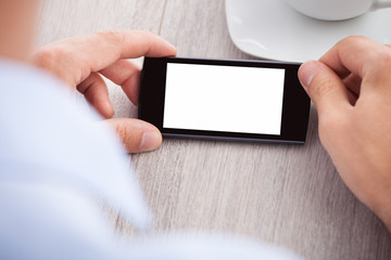 Businessman's Hand Holding Smartphone With Blank Screen