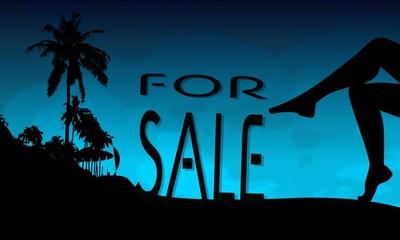 sale sign on a beach