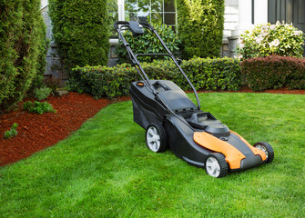 Wall Mural - Electric Battery Lawn Mower on Front Yard