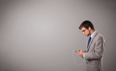 handsome man singing and listening to music with copy space