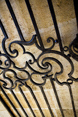 Wrought iron gate of an old French stoned house