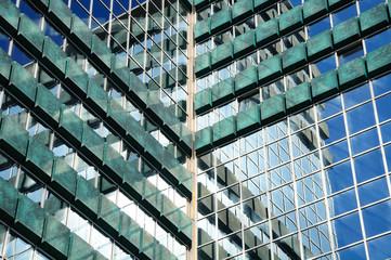 Reflection in glass wall of modern building  Tel Aviv.  Israel.