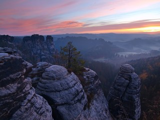 Autumn early morning view over rock empires to fall valley