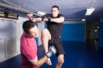 knee kick during mma training