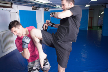 kick with knee in the beard during martial arts training