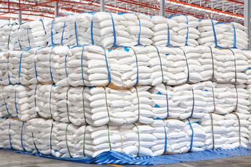 stacked sacks of meal in warehouse waiting for transportation
