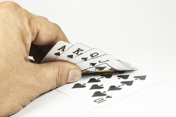 royal flush playing cards in hand