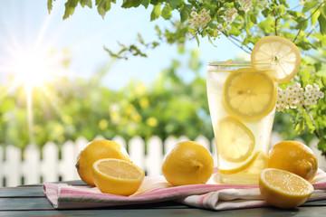 Citrus lemonade in garden setting.