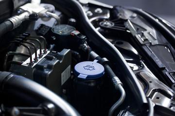 Blue liquid caps inside a car engine