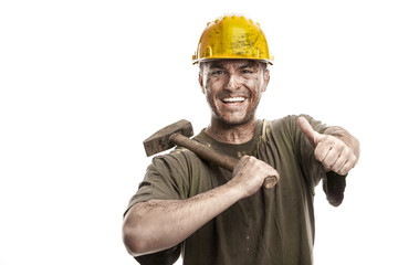 Young dirty smiling Worker Man With Hard Hat helmet  .holding a