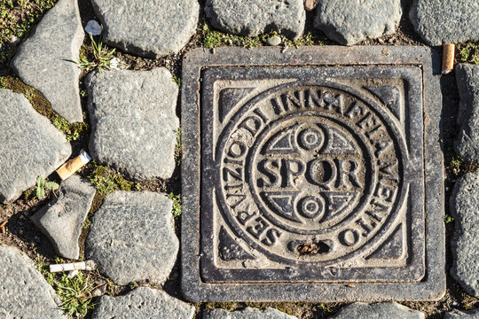 Roman Drain Cover with sign and abbreviation SPQR