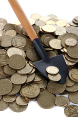 Coins with shovel close up